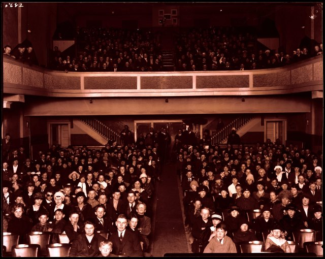 Photograph of an audience in the Empress Theater in Laramie after the Spanish flu crisis had passed, 1919. Ludwig & Svenson Photograph Collection, Accession Number 167.