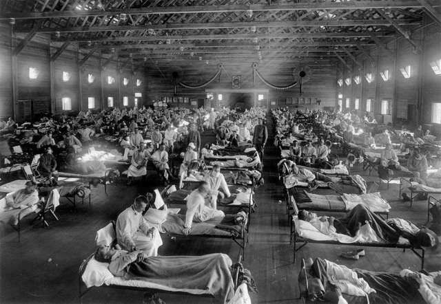 U.S. Army flu victims fill an emergency hospital near Fort Riley, Kansas, 1918. Photo from the National Museum of Health.