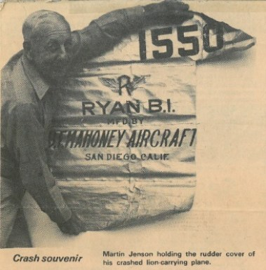 Martin Jensen is seen in this 1991 newspaper article holding the rudder cover of his plane that crashed in the Arizona desert. Box 1, Martin Jensen papers, American Heritage Center, University of Wyoming.