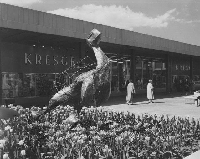 Flowers surrounded a piece of modern art at Northland Shopping Center. Victor Gruen papers, American Heritage Center, University of Wyoming.