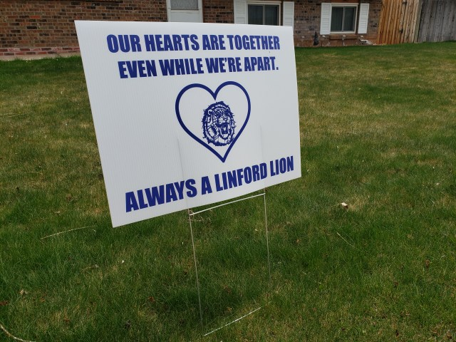 "A yard sign at Laramie's Linford Elementary School depicts a message of caring to the community. It reads, ""Our Hearts Are Together Even While We're Apart. Always a Linford Lion."" Photo taken by AHC Archivist Sara Davis."