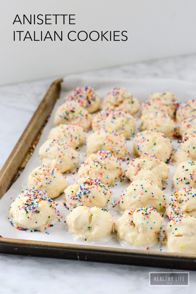Annisette Italian Cookie Recipe delicate cake like cookies glazed and topped with sprinkles   ahealthylifeforme.com