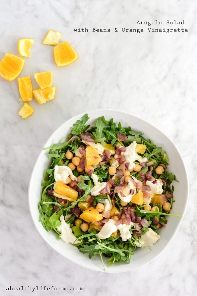 Arugula Salad with Beans and Orange Vinaigrette is a bright, sweet and savory summer salad. Loaded with peppery arugula, sauteed red onion, fresh orange, creamy burrata cheese topped with sweet orange vinaigrette | ahealthylifeforme.com