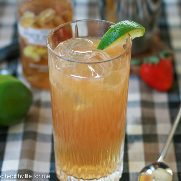 Kentucky Buck with Bourbon, Ginger Soda, Lime Juice, Bitters, Strawberry