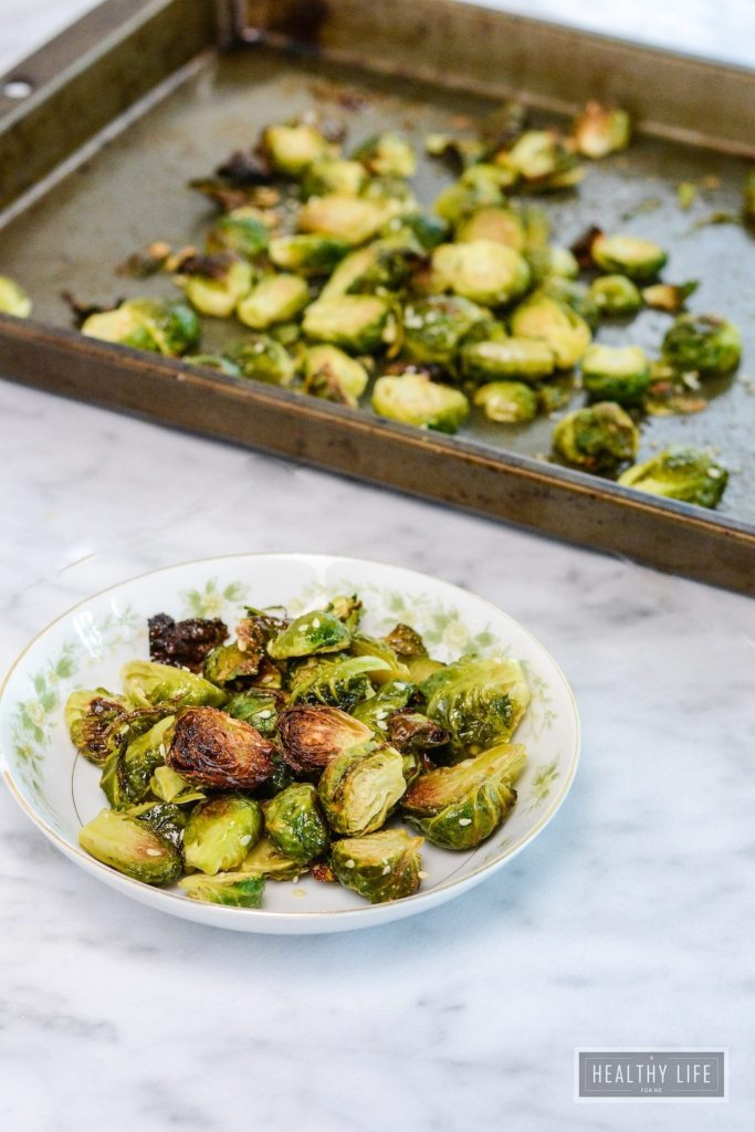 Maple Sesame Roasted Brussels Sprouts are sweet and nutty in flavor. They take minutes to prepare and are ready in less than 30 minutes   ahealthylifeforme.com