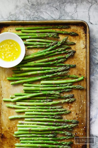 Sesame Roasted Asparagus a delicious healthy quick side dish that works perfectly paired with any protein   ahealthylifeforme.com