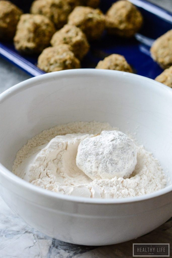 This Eggplant Meatball recipe is made with roasted eggplant, creamy salty parmesan cheese, Italian breadcrumbs and fresh basil and parsley packed into a balls, and then lightly fried, served topped with marinara sauce. | ahealthylifeforme.com