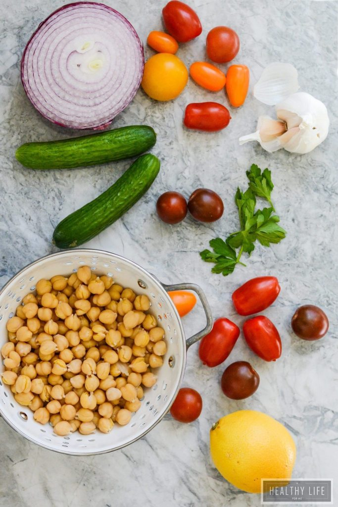 This Lemony Chickpea Salad features bright colors and equally bright flavors. A hearty recipe that is quick to assemble and loaded with healthy ingredients. This is a diary free recipe making it a perfect choice to bring to your next barbecue gluten free recipe   ahealthylifeforme.com