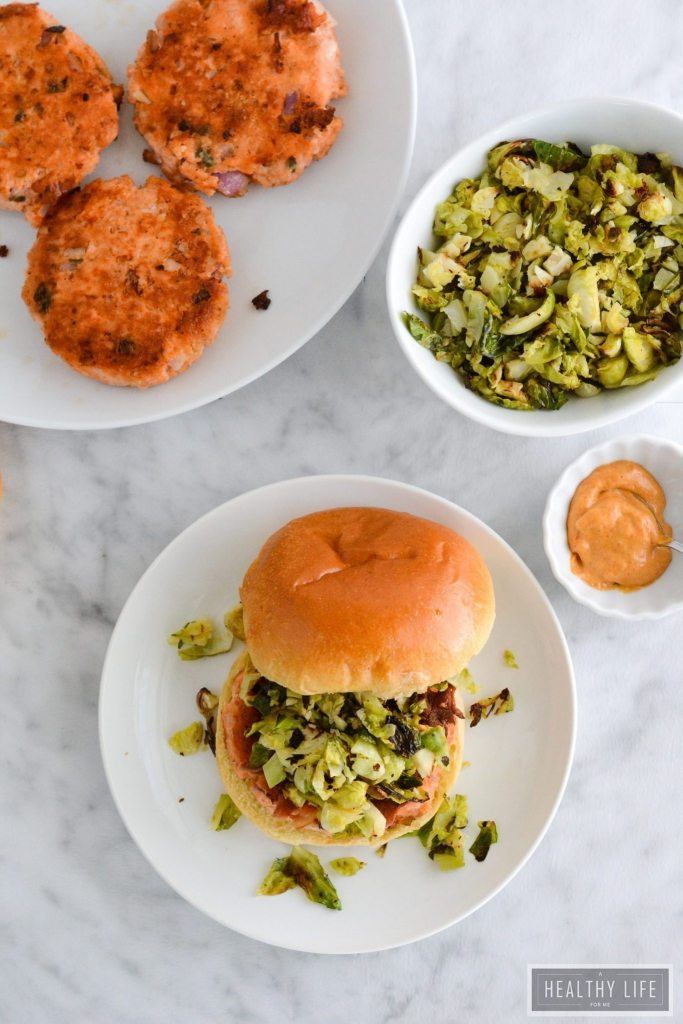 Spicy Salmon Burger Recipe with Roasted Brussels Sprout Slaw | ahealthylifeforme.com
