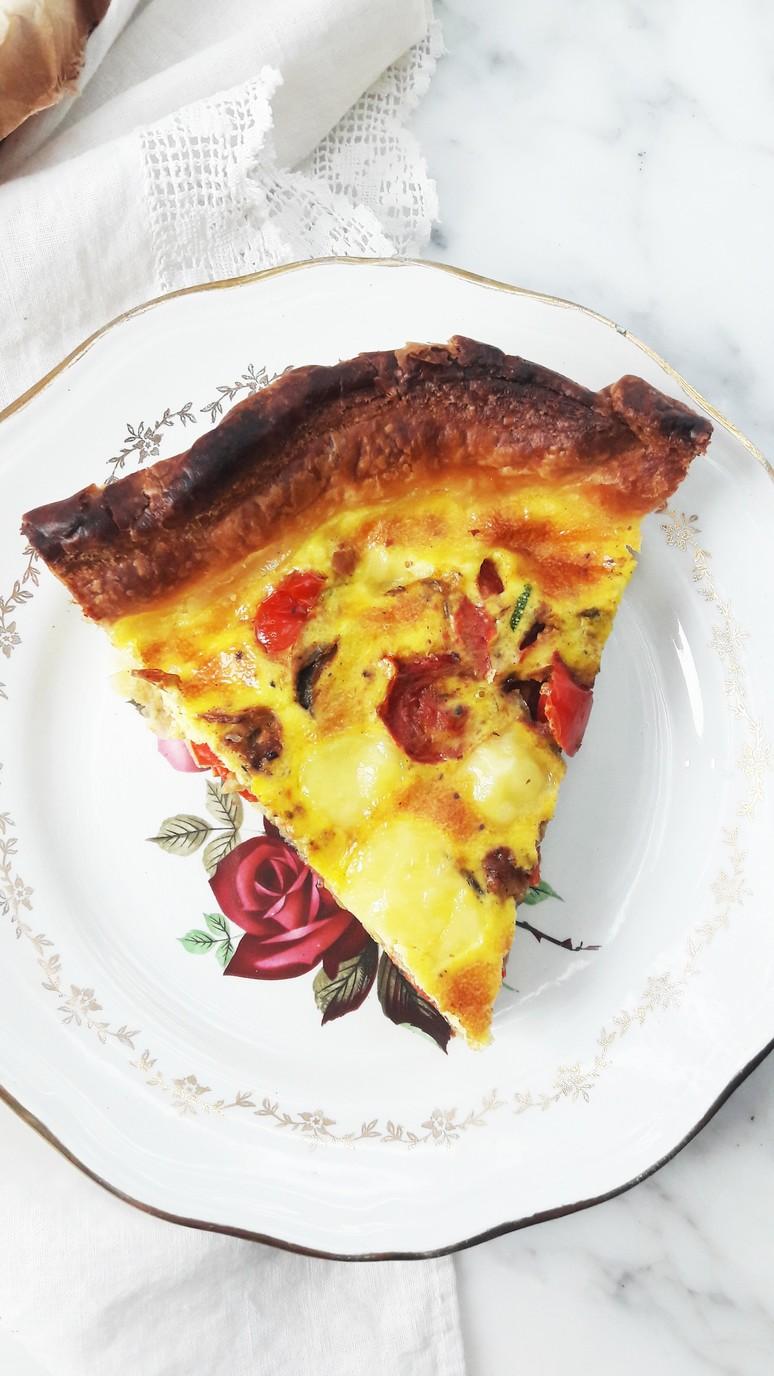 Blissful mediterranean quiche. Red pepper, red onion, garlic, zucchini & tomato make this quiche tasty & nutritious.   ahedgehoginthekitchen.com