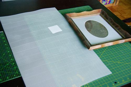 old frame and needlework sheet