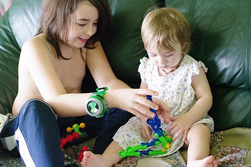 Xavier showing Wilhelmina how to build