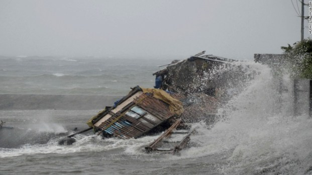 A house in the city of Legazpi in Albay province is engulfed by the storm surge brought about by powerful typhoon.