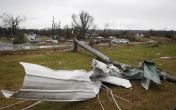 Debris lays scattered along the road after a tornado hit in Adairsville, Georgia, January 30, 2012. Tornadoes were reported in four states killing two people including one in Adairsville as an Artic cold front clashed with warm air producing severe weather over a wide swath of the nation. REUTERS/Tami Chappell