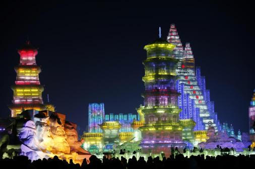 Visitors are silhouetted against lighted ice sculptures at the Harbin Ice and Snow Sculpture Festival in the northern city of Harbin, Heilongjiang province January 5, 2014. The festival kicks off on Sunday. (REUTERS/Kim Kyung-Hoon)