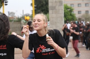 A student blows bubbles during the flashmob