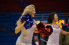 Two Rock Chalk Dancers dance at the women's basketball game against Fort Hays State on Oct. 30. The Jayhawks won 98-71. Ashley Hocking/KANSAN