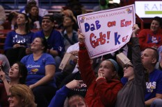 Young KU fans watch the women's basketball game and hold up a sign during the game against Oral Roberts University on Nov 23. The Jayhawks won 64-56. Ashley Hocking/KANSAN