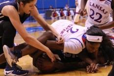 Sophomore McKenzie Calvert, a guard from Schertz, Texas, tries to wrestle the ball away from an Oral Roberts University player during the women's basketball game at Allen Fieldhouse on Nov. 23. The Jayhawks won 64-56. Ashley Hocking/KANSAN