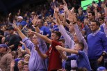 Fans in the crowd at the basketball game on Nov. 25 against UNC Asheville try to catch a t-shirt during the t-shirt toss. The Jayhawks won 95-57. Ashley Hocking/KANSAN