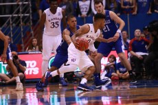Guard Frank Mason, a senior from Petersburg, Virginia, maintains dribbles the ball toward the basket during the second half of the game on Nov. 25. Kansas beat UNC Asheville 95-57 at Allen Fieldhouse. Ashley Hocking/KANSAN
