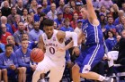 Guard Frank Mason, a senior from Petersburg, Virginia, dodges a UNC Asheville player during the basketball game against UNC Asheville on Nov. 25. The Jayhawks won 95-57 at Allen Fieldhouse. Ashley Hocking/KANSAN