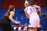 Guard Kylee Kopatich, a sophomore from Olathe, keeps the ball away from a North Dakota player during the women's basketball game on Nov. 27. Kansas won 76-71 in overtime. Ashley Hocking/KANSAN