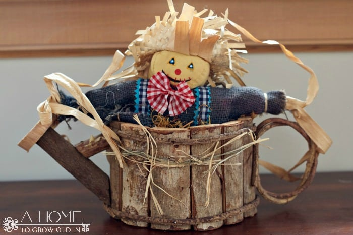 Scarecrow in a Log
