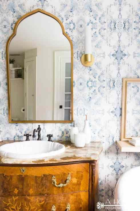 "You won't believe the transformation in this easy bathroom makeover! It went from ""blah"" to modern and fresh with just a few easy DIY projects."