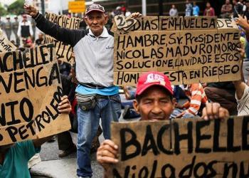 Protestas en las calles de Caracas durante la segunda jornada de visita de Bachelet.   AFP