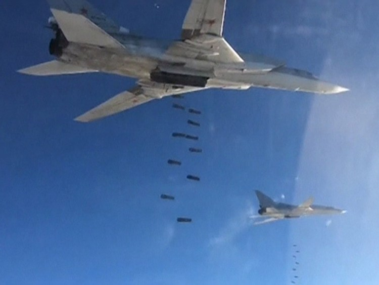 A still image taken from video footage, released by Russia's Defence Ministry on November 20, 2015, shows Russian Tupolev TU-22 long-range strategic bombers conducting an airstrike at an unknown location in Syria. REUTERS/Ministry of Defence of the Russian Federation/Handout via Reuters ATTENTION EDITORS - THIS IMAGE WAS PROVIDED BY A THIRD PARTY. REUTERS IS UNABLE TO INDEPENDENTLY VERIFY THE AUTHENTICITY, CONTENT, LOCATION OR DATE OF THIS IMAGE. FOR EDITORIAL USE ONLY. NOT FOR SALE FOR MARKETING OR ADVERTISING CAMPAIGNS. FOR EDITORIAL USE ONLY. NO RESALES. NO ARCHIVE. THIS IMAGE HAS BEEN SUPPLIED BY A THIRD PARTY. IT IS DISTRIBUTED, EXACTLY AS RECEIVED BY REUTERS, AS A SERVICE TO CLIENTS.