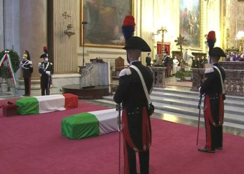 The coffins containing the bodies of Italian ambassador Luca Attanasio and his bodyguard Vittorio Iacovacci, who were killed in an attack in the Democratic Republic of Congo, are seen inside Santa Maria degli Angeli church during their funeral, in Rome, Italy, February 25, 2021 in this screenshot taken from a video. Rai Pool/Handout via REUTERS ATTENTION EDITORS THIS IMAGE HAS BEEN SUPPLIED BY A THIRD PARTY