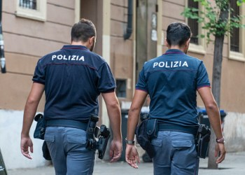 Rome, Italy - August 8, 2018: Two back turned unidentifiable Italian policemen walking outdoors