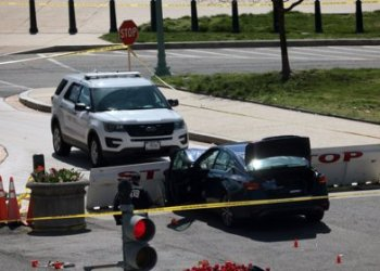 WASHINGTON, DC - APRIL 02:  Law enforcement investigate the scene after a vehicle charged a barricade at the U.S. Capitol on April 02, 2021 in Washington, DC. The U.S. Capitol was briefly locked down after a person reportedly rammed a vehicle into multiple Capitol Hill police officers. One officer was killed and one was wounded. The suspect who exited the vehicle with a knife was shot and later died. (Photo by Win McNamee/Getty Images)