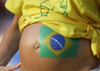 A pregnant Brazilian supporter with a painted flag on her belly before the Confederations Cup soccer match between Mexico and Brazil in Hanover.   A pregnant Brazilian supporter with a painted flag on her belly before the Confederations Cup soccer match between Mexico and Brazil in Hanover, Germany June 19, 2005. REUTERS/Ina Fassbender - RTRWKDL