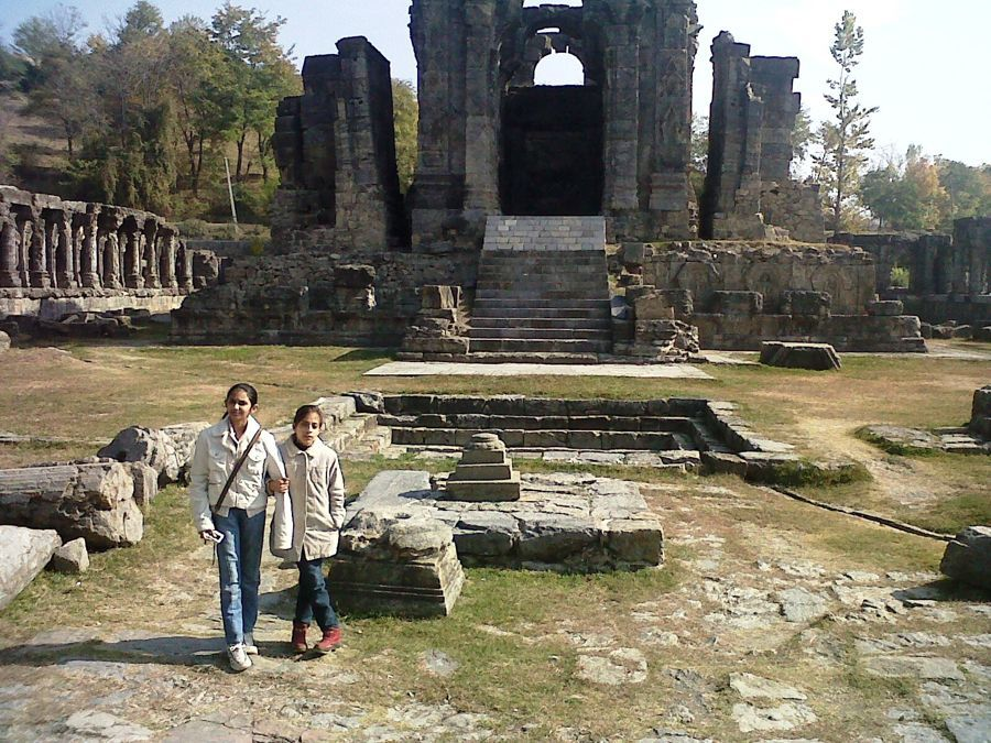 The kids roaming in the ancient ruins