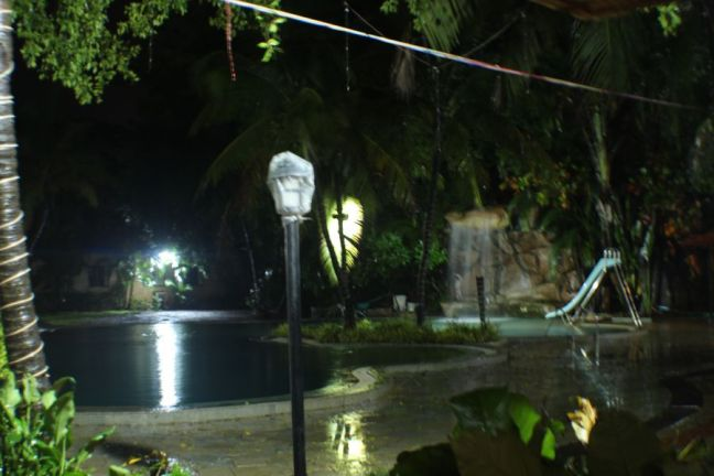 Pool and waterfall at night at the Treasure Island Resort, Lonavala