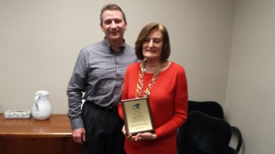 Ass't City Manager Don Grice presented her with a plaque