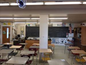 Column obstructs students view in science classroom.