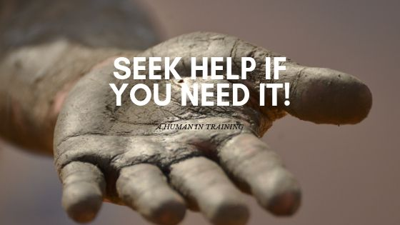 a hand extending out, covered in dirt, to say seek help if you need it