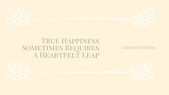 yellow banner with the words: True Happiness Sometimes Requires A Heartfelt Leap