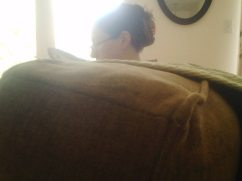 Mama sitting on the couch.