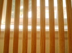 The bars of the back of the living room rocking chair.