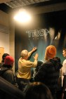 Bruce Boxleitner signs a giant Tron poster that was hanging up at one of our locations, Compass College for Cinematic Arts in Grand Rapids, Michigan