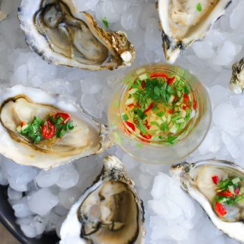 Oysters with a ginger, chilli rice vinegar dressing