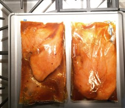 Marinated chicken on a cookie sheet