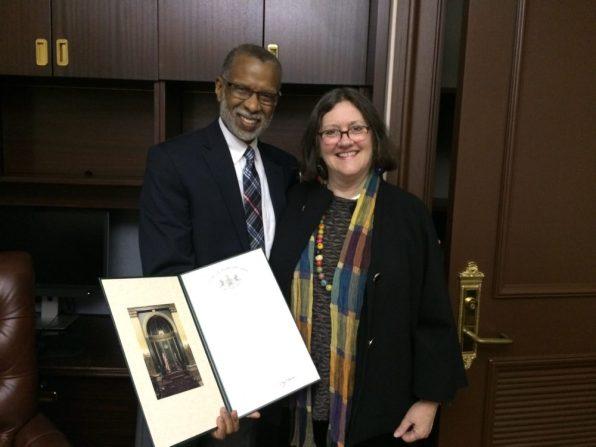 Senator Art Haywood presents immediate past President Elizabeth (Betsy) Masters with a Senate Citation for her community service.