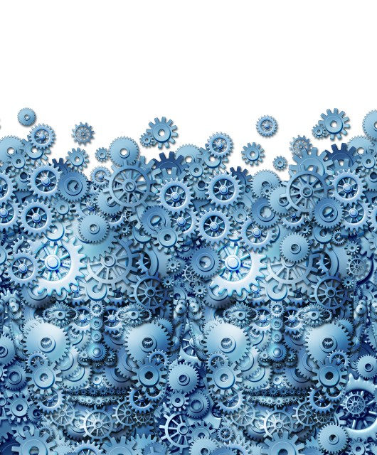 Teamwork concept as a working business group of human heads shaped with machine gears and cog wheels connected together as a technology symbol for future computing collaboration through social media on a white background.