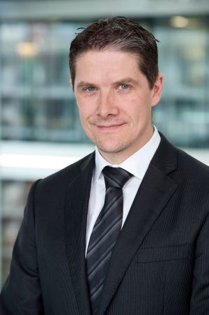 A headshot of Christian Westermann, Partner of Data & Analytics with PwC Switzerland specialising in financial services