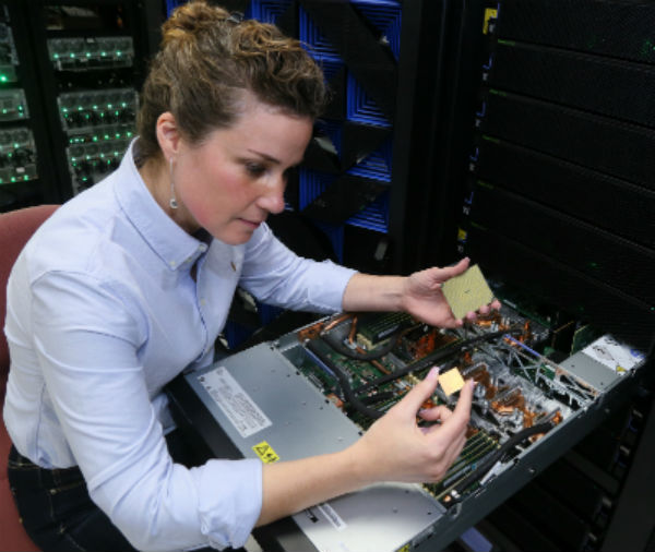IBM Engineer, Stefanie Chiras, with the IBM Power System AC922 - POWER9. (Photo: Jack Plunkett).